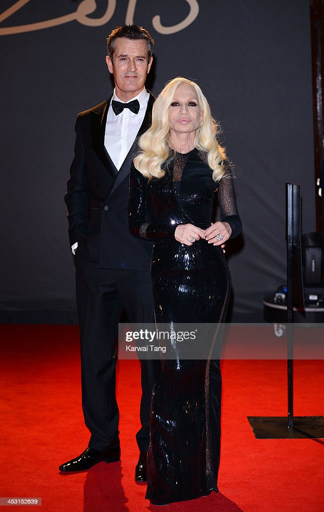 Donatella Versace and <a gi-track='captionPersonalityLinkClicked' href=/galleries/search?phrase=Rupert+Everett&family=editorial&specificpeople=206208 ng-click='$event.stopPropagation()'>Rupert Everett</a> attend the British Fashion Awards 2013 held at the London Coliseum on December 2, 2013 in London, England.