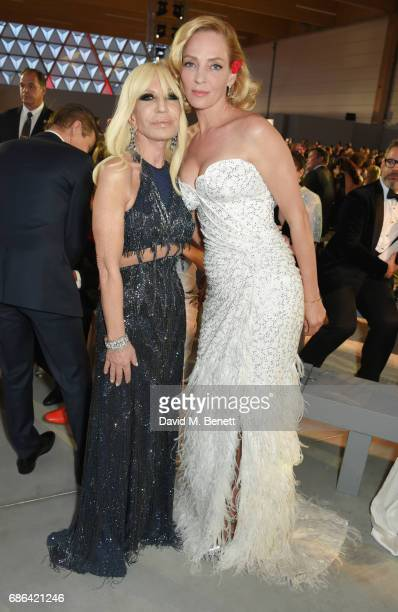 Donatella Versace and Uma Thurman attend the Fashion for Relief event during the 70th annual Cannes Film Festival at Aeroport Cannes Mandelieu on May...