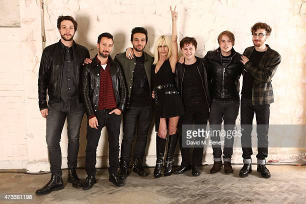 Donatella Versace centre and Antonio Vaccarello pose with band Nothing But Thieves Phil Blake Conor Mason Joe Langridge Brown and James Price at the...