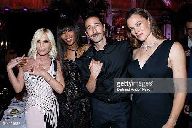 Donatella Versace model Naomi Campbell actors Adrien Brody and Jennifer Garner attend the Amfar Paris Dinner Stars gather for Amfar during the Haute...