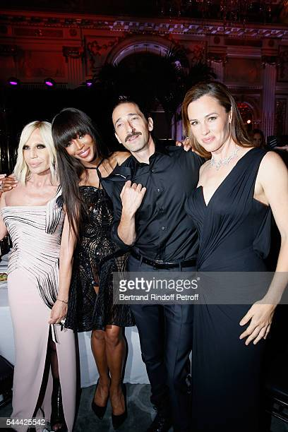 Donatella Versace model Naomi Campbell actors Adrien Brody and Jennifer Garner attend the Amfar Paris Dinner Stars gather for Amfar during the Haute...