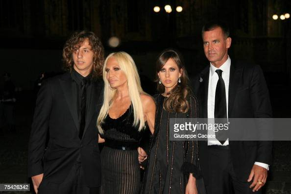 Donatella Versace poses with her son Daniel daughter Allegra and Paul Back as they arrive at the dinner at Palazzo Reale after the ballet 'Thanks...