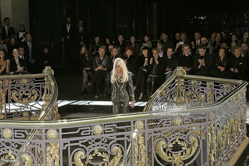 Donatella Versace walks down the stairs after she acknowledged applause following the Versace Spring/Summer 2013 Haute-Couture show as part of Paris Fashion Week at Le Centorial on January 20, 2013 in Paris, France.