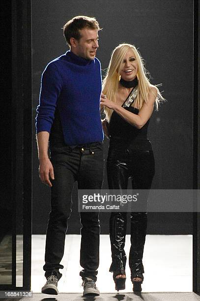 Donatella Versace walks the runway during the Versus Versace launch hosted by Donatella Versace at the Lexington Avenue Armory on May 15 2013 in New...