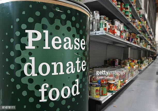 A donation bin sits near shelves with canned foods at the San Francisco Food Bank June 23 2008 in San Francisco California With schools breaking for...