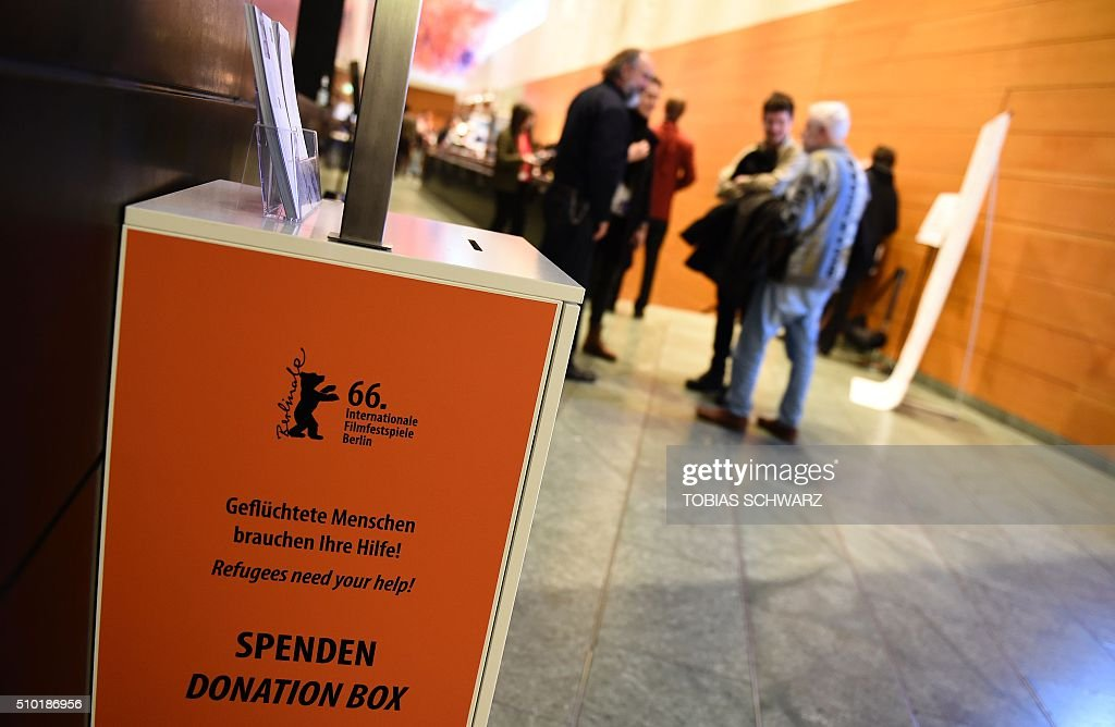 A donation box for refugees is pictured at a floor at the 66th Berlinale Film Festival in Berlin on February 13, 2016. / AFP / TOBIAS SCHWARZ
