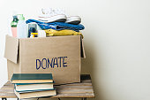 CLOTHES DONATION AND FOOD DONATION CONCEPT. Donation box with clothes and hygiene products. Copy space