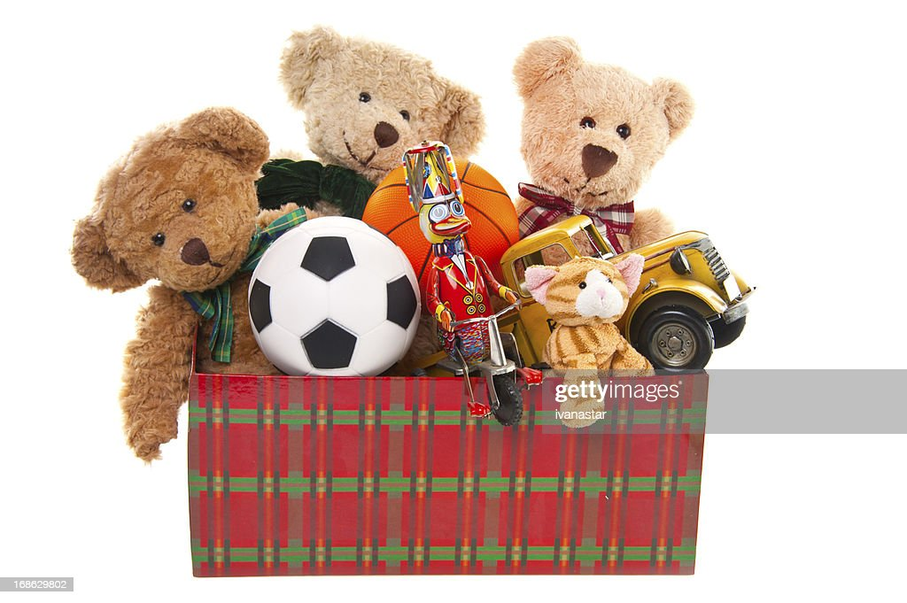 Toys For Donation : Donation box with teddy bear balls and toys stock photo