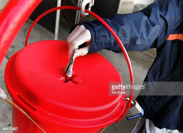 A donation is made into Salvation Army bell ringer Juanita Brown's red Holiday donation kettle December 20 2005 in Park Ridge Illinois Since 1865 the...