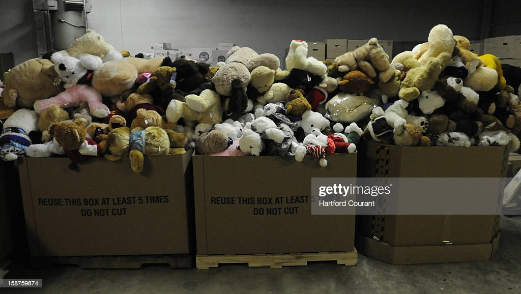Donations sit in boxes at a warehouse in Newtown, Connecticut, on Thursday, December 27, 2012, where thousands of stuffed animals, toys and other gifts have been arriving after the Sandy Hook Elementary School shooting.