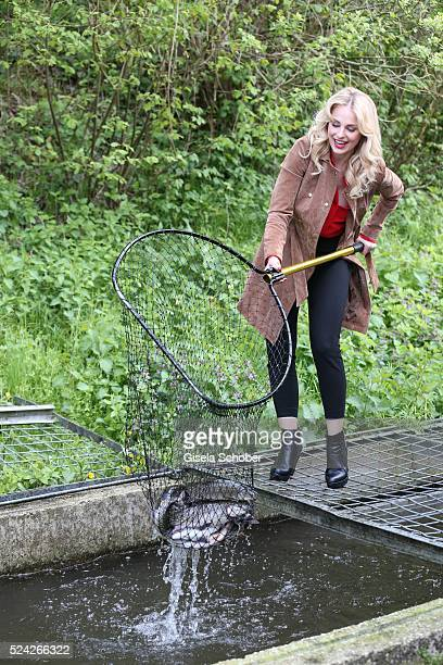 Donau Testimonial Silvia Schneider fishes living trouts during the 'Genuss am Fluss' cooking event at Hotel 'Donauschlinge Schloegen' on April 25...