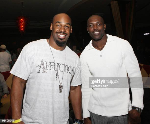 Donavan McNabb of the Philadelphia Eagles and Terrell Owens of the Buffalo Bills attend the Moves Magazine Annual Super Bowl Gala on February 3 2010...