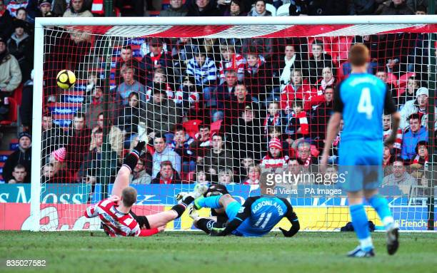Doncaster keeper Neil Sullivan saves a shot from Aston Villa's Gabriel Agbonlahor during the FA Cup Fourth Round at Keepmoat Stadium Doncaster