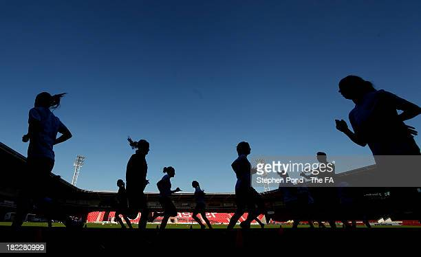 Doncaster Rovers Belles players warm up before the FA WSL match between Doncaster Rover Belles and Birmingham City Ladies at Keepmoat Stadium on...