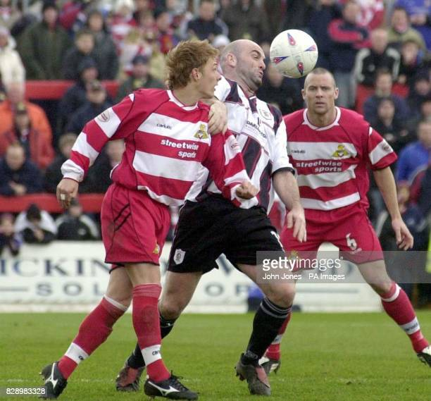 Doncaster Rovers' Dave Mulligan and Darlington's Barry Conlon vie for possession as Doncaster's Mark Albrighton looks on during their Nationwide...