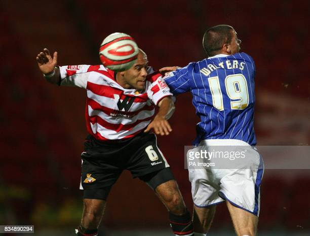 Doncaster Rovers James Chambers and Ipswich Town's Jonathan Walters during the CocaCola Football Championship match at Keepmoat Stadium Doncaster