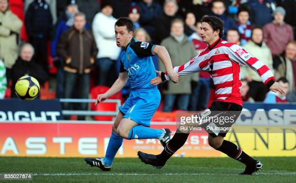 Doncaster Rovers' John Spicer and Aston Villa's Nicky shorey battle for the ball during the FA Cup Fourth Round at Keepmoat Stadium Doncaster