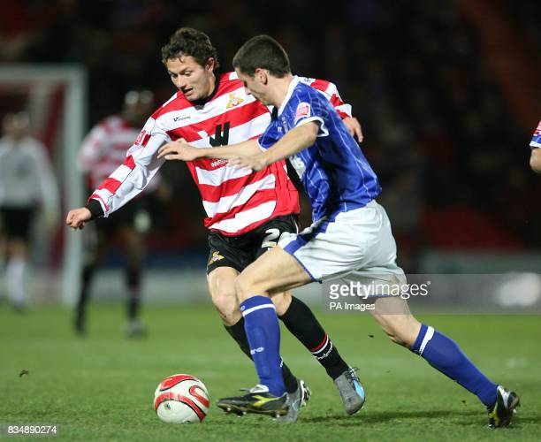 Doncaster Rovers John Spicer and Ipswich Town's Alex Bruce during the CocaCola Football Championship match at Keepmoat Stadium Doncaster