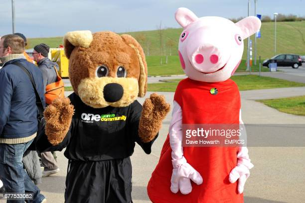 Doncaster Rovers mascot Donny Dog and Peppa Pig outside the Keepmoat Stadium