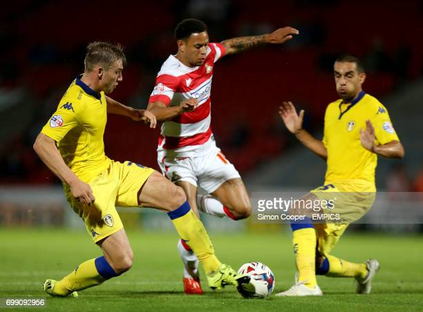 Doncaster Rovers' Nathan Tyson takes on Leeds United's Giuseppe Bellusci and Charlie Taylor