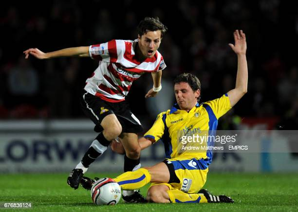 Doncaster Rovers' Ryan mason is tackled by Leeds United's Alex Bruce