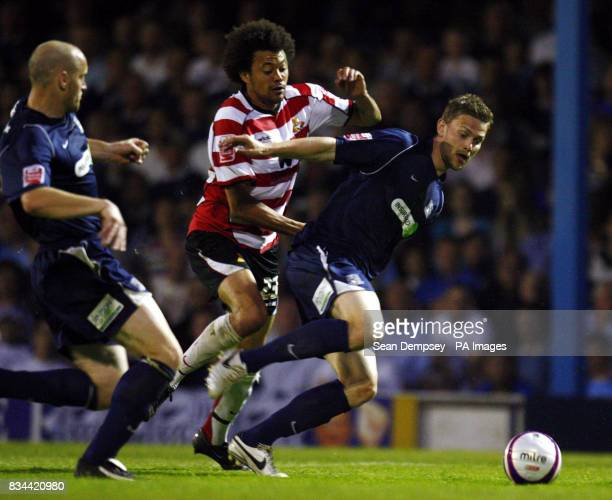 Doncaster's Jason Price and Southend's Simon Francis during the CocaCola football League One Play Off Semi Final First leg match at Roots Hall...
