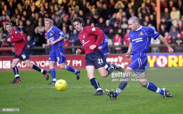Doncaster's Mark Albrighton slides the ball past York City's Gary Browne during the Nationwide Division Three match at Bootham Crescent York THIS...