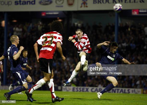 Doncaster's Paul Heffernan has a shot on goal during the CocaCola football League One Play Off Semi Final First leg match at Roots Hall Southend