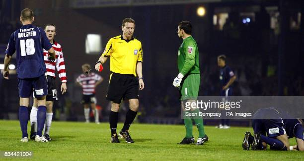 Doncaster's Paul Heffernan is sent off for a head butt on Southend's Charlie Mulgrew during the CocaCola football League One Play Off Semi Final...