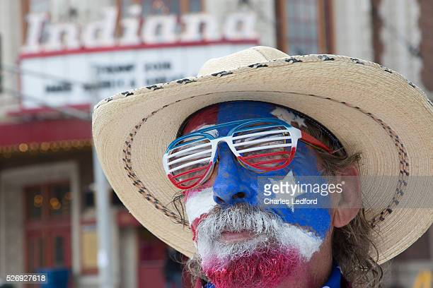 Dondald Trump supporter Marcos Spence of Dallas Texas painted his face for a Trump rally at the Indiana Theater on May 1 2016 in Terre Haute Indiana...