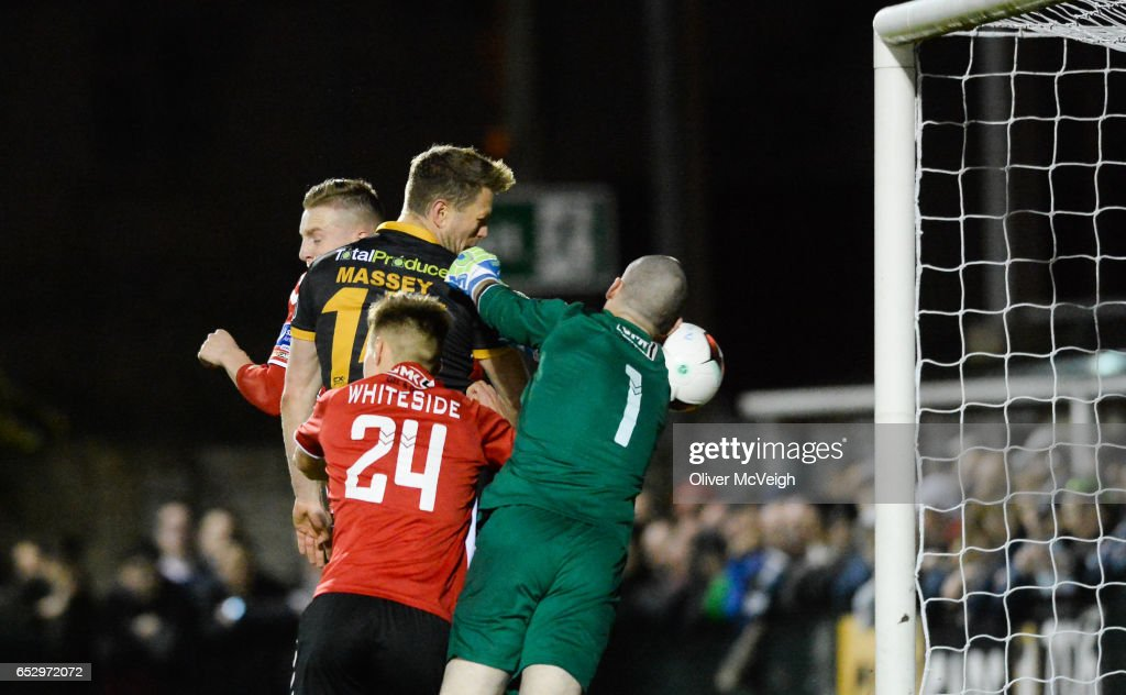 Donegal , Ireland - 13 March 2017; Dane Massey of Dundalk scores his side's first goal despite the attempts of Gerard Doherty of Derry City during the SSE Airtricity League Premier Division match between Derry City and Dundalk at Maginn Park in Buncrana, Donegal.