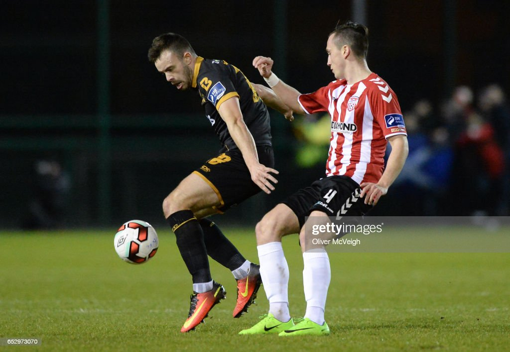 Donegal , Ireland - 13 March 2017; Robbie Benson of Dundalk in action against Aaron McEneff of Derry City during the SSE Airtricity League Premier Division match between Derry City and Dundalk at Maginn Park in Buncrana, Donegal.
