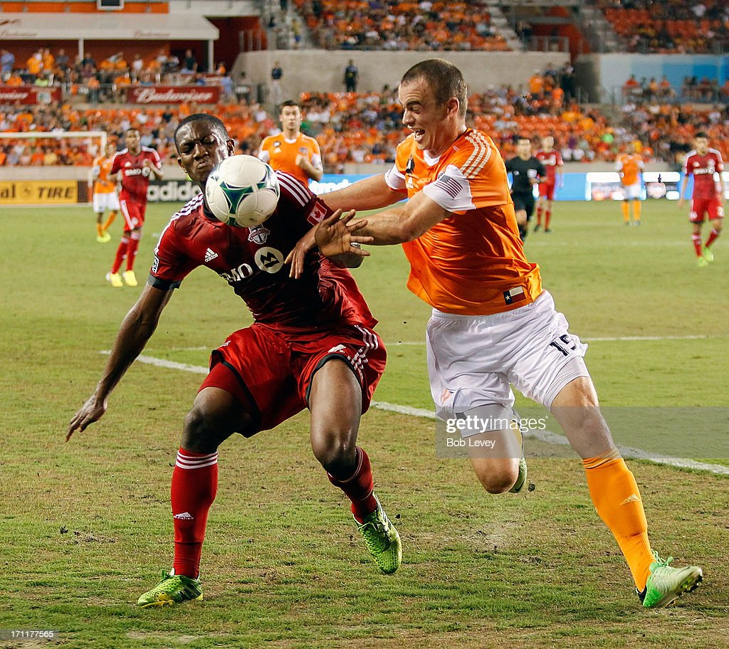 Doneil Henry #4 and Cam Weaver #15 of Houston Dynamo battle for the ball in the second half at BBVA Compass Stadium on June 22, 2013 in Houston, Texas.
