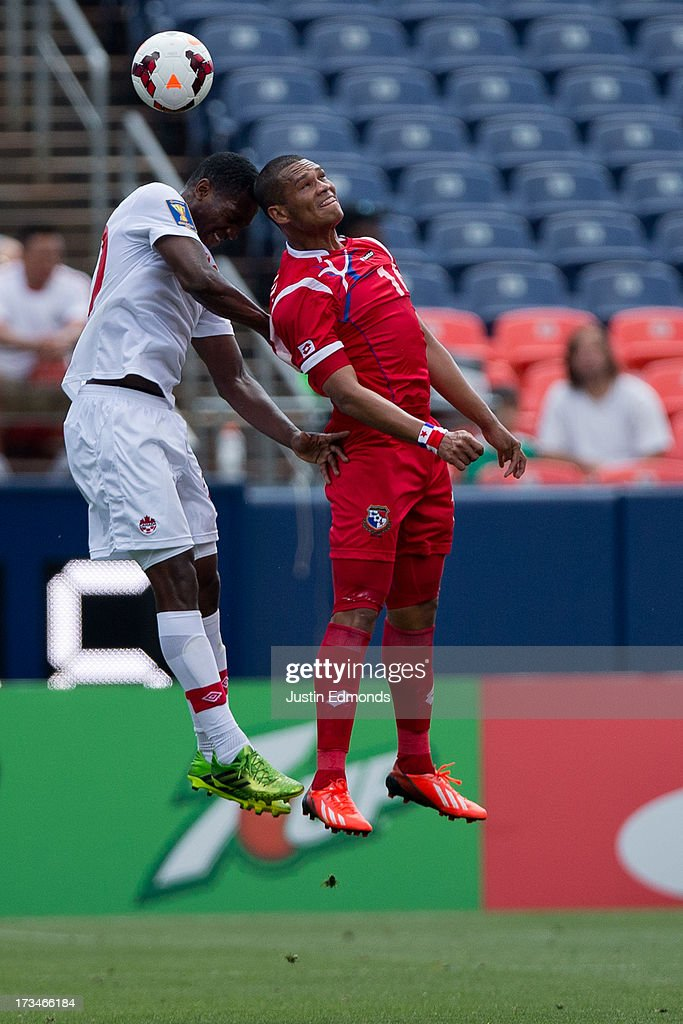 Doneil Henry #20 of Canada and Rolando Blackburn #16 of Panama battle in the air for a ball during the first half of a CONCACAF Gold Cup match at Sports Authority Field at Mile High on July 14, 2013 in Denver, Colorado.