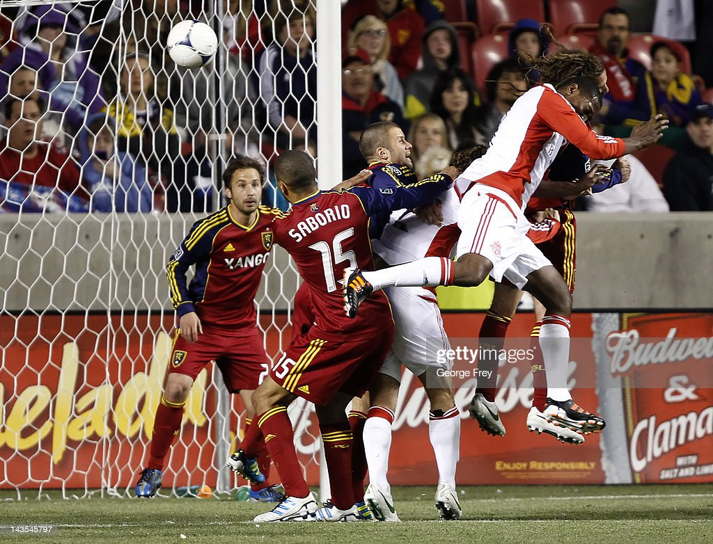 Doneil Henry of Toronto FC heads a ball in for a goal as Tony Beltran Alvaro Saborio Chris Wingert and Kyle Beckerman of Real Salt Lake defends...