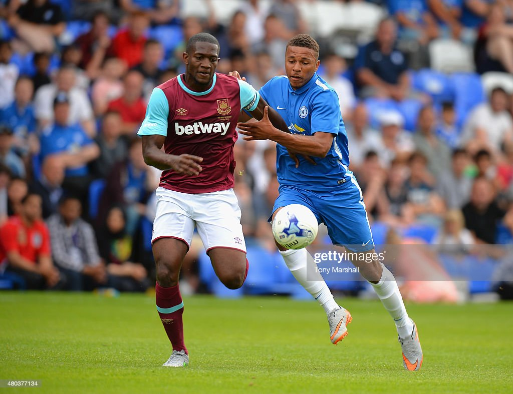 Doneil Henry of West Ham United is tackled by Jonny Edwards of Peterborough United during the Pre Season Friendly match between Peterborough United and West Ham United at London Road Stadium on July 11, 2015 in Peterborough, England.