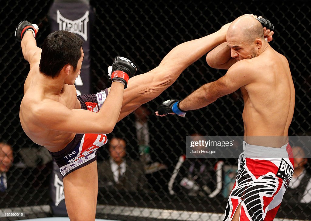 Dong Hyun Kim kicks Siyar Bahadurzada in their welterweight fight during the UFC on FUEL TV event at Saitama Super Arena on March 3, 2013 in Saitama, Japan.