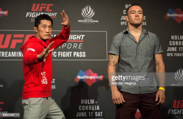 Dong Hyun Kim of South Korea and Colby Covington of the United States pose for a picture during the UFC Fight Night Ultimate Media Day at the Marina...