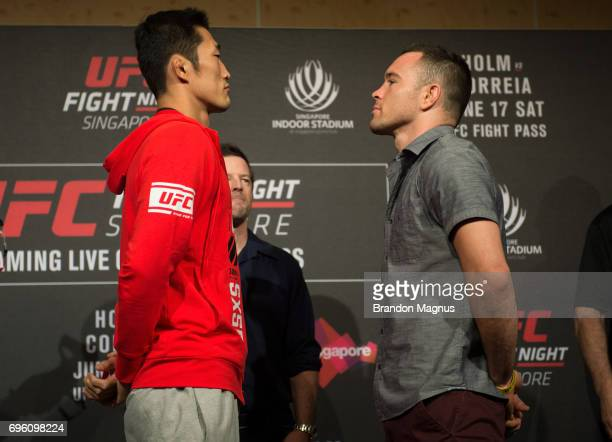 Dong Hyun Kim of South Korea and Colby Covington of the United States face off during the UFC Fight Night Ultimate Media Day at the Marina Bay Sands...
