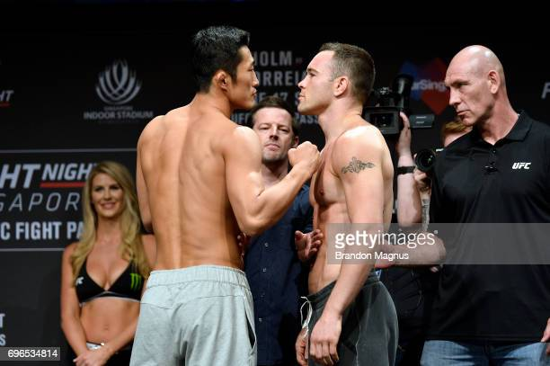 Dong Hyun Kim of South Korea and Colby Covington of the United States face off during the UFC Fight Night weighin at the Marina Bay Sands on June 16...