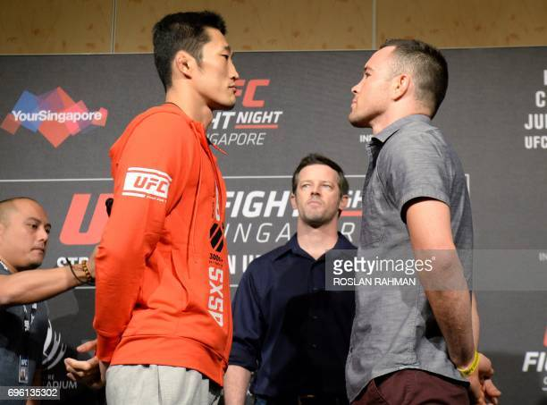 Dong Hyun Kim of South Korea and Colby Covington of the US face off against each other during the UFC Fight Night media event in Singapore on June 15...