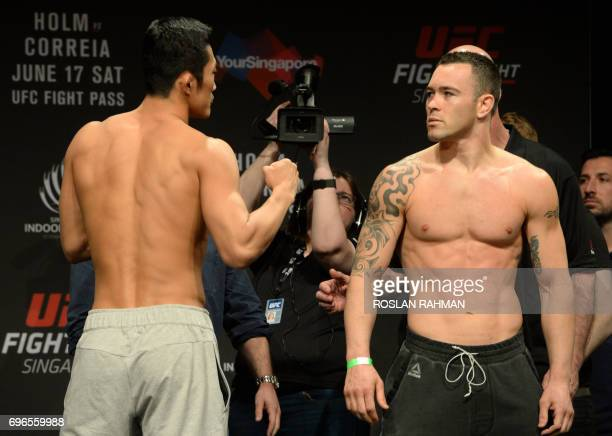 Dong Hyun Kim of South Korea and Colby Covington of the US face off against each other during the UFC Fight Night official weignin in Singapore on...