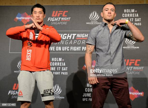 Dong Hyun Kim of South Korea and Colby Covington of the US gesture during the UFC Fight Night media event in Singapore on June 15 2017 / AFP PHOTO /...