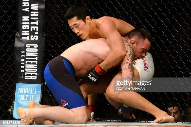 Dong Hyun Kim of South Korea competes against Colby Covington of the US during their UFC welterweight event at the UFC Fight Night in Singapore on...