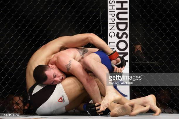 Dong Hyun Kim of South Korea fights Colby Covington of United States in the Welterweight Bout during UFC Singapore Fight Night at Singapore Indoor...
