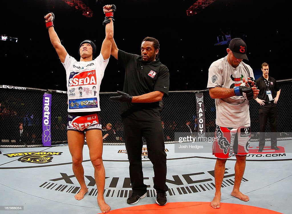 Dong Hyun Kim (L) reacts after defeating Siyar Bahadurzada in their welterweight fight during the UFC on FUEL TV event at Saitama Super Arena on March 3, 2013 in Saitama, Japan.