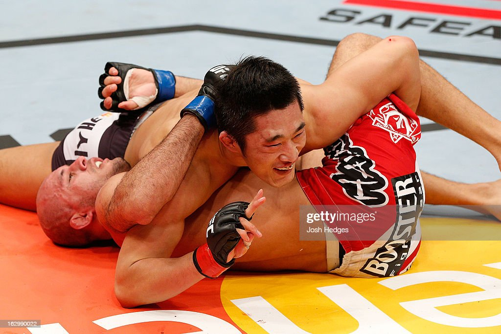 Dong Hyun Kim smiles at his corner during his welterweight fight against Siyar Bahadurzada during the UFC on FUEL TV event at Saitama Super Arena on March 3, 2013 in Saitama, Japan.