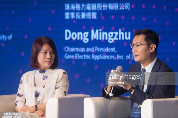 Dong Mingzhu chairman of Gree Electric Appliances Inc left looks on as billionaire Ma Huateng chairman and chief executive officer of Tencent...