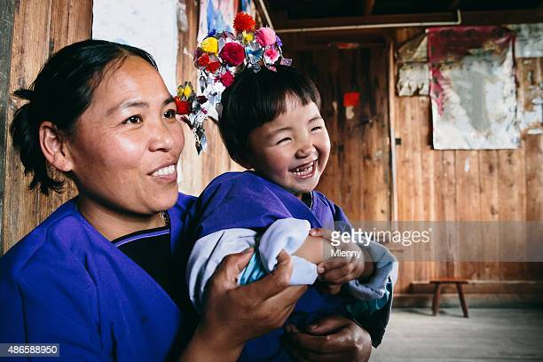 Dong People Happy Mother and Daughter in their Home, China
