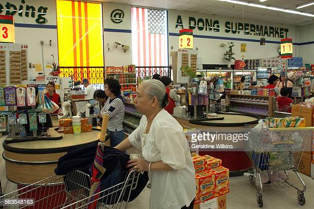 A Dong supermarket in Westminster's little Saigon has a former South Vietnam flag and an American flag drapped in the front windows Garden Grove's...